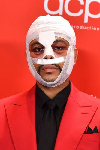The Weeknd's Bandaged Face at the American Music Awards Has a Powerful Message